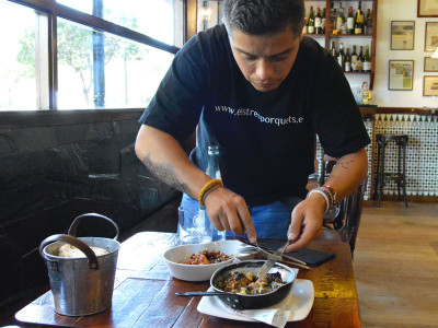 Els Tres Porquets' Marc Cuenca mixes fried duck egg into mushrooms with foie gras, photo by Paula Mourenza