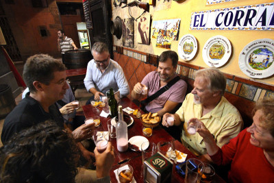 Toasting with leche de pantera at Tasca El Corral, photo by Sam Zucker