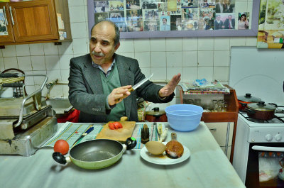 """İsmail Amca, with his """"wall of fame"""" in the background, photo by İpek Derin Baltutan"""