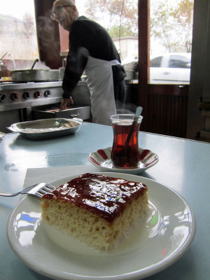 A slice of trileçe at Köfteci Arnavut, with Ali İştay manning the stoves in the background, photo by Ansel Mullins