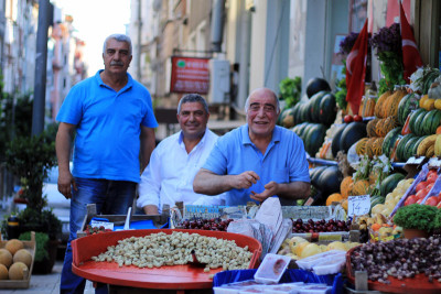Kemal, Uğur and Alaattin at their produce stand, photo by Evan Woodnorth