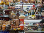 A stall selling beans, dried fruit, meat and cheeses in the Coyoacán market.