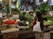 Elevated market stalls selling fresh produce.