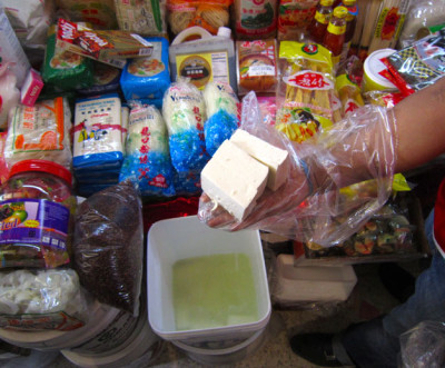 Fresh, locally made tofu at Pugibet market's Productos Orientales stand, photo by James Young