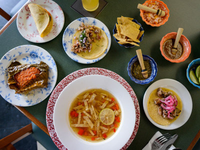 Sopa de lima and assorted antojitos at Riviera del Sur, photo by PJ Rountree