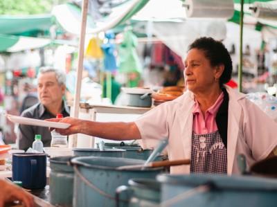 Señora Ema at her food stand, photo by Ben Herrera